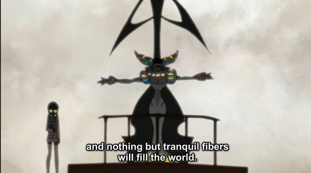 """A screenshot shows Ragyo standing on a podium with her arms spread. She says, """"and nothing but tranquil fibers will fill the world."""""""